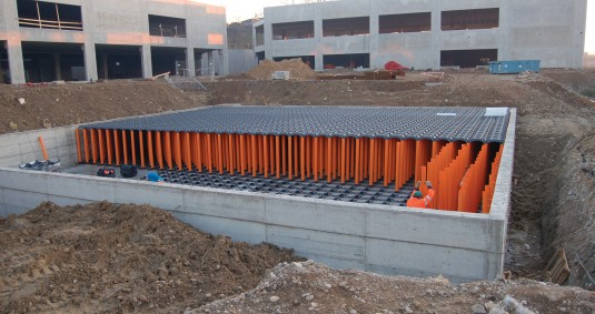 Elevator - adoptable in-situ cast concrete attenuation and water storage tanks
